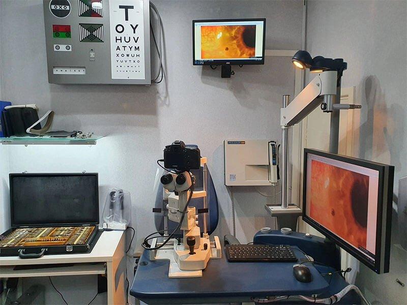consulting room simon kleyn optometrist opticians showing lenses slit lamp microscope